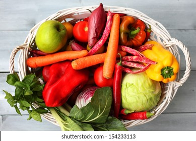 Photo of white basket with vegetables