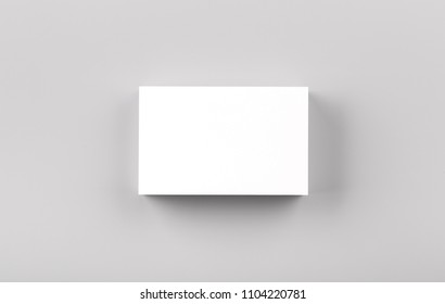 Photo of white business cards isolated on gray background. Template for branding identity. For graphic designers presentations and portfolios. Business Card isolated on gray. White business card mock-