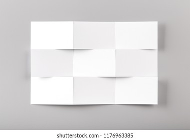 Photo of white business cards isolated on gray background. For graphic designers presentations and portfolios. Business Card isolated on gray. White business card mock-up.