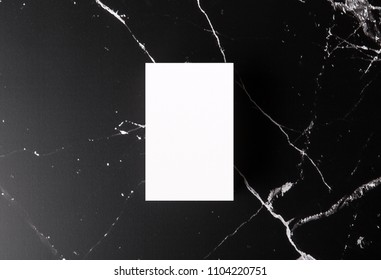 Photo of white business cards on marble. Template for branding identity isolated on marble background. For graphic designers presentations and portfolios marble premium luxury mock-up.