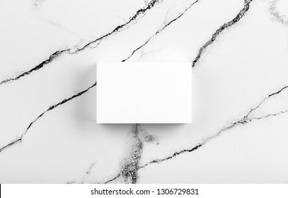 Photo of white business cards on white marble. Template for branding identity isolated on marble background. For  presentations and portfolios marble premium luxury mock-up. Business Card isolated