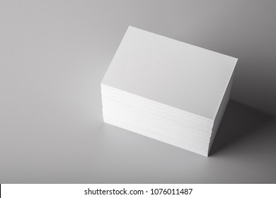 Photo of white business cards. Template for branding identity. For graphic designers presentations and portfolios. Business Card isolated on gray. White business card mock-up. Photo mock up.