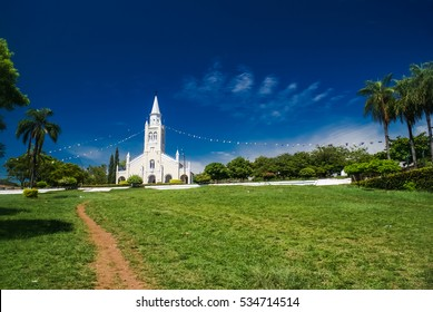 Photo of white church situated in greenery of Aregua, city in Paraguay.