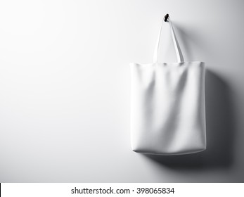 Photo white cotton textile bag hanging right side. Empty concrete wall background. Highly detailed texture, space for advertising. Horizontal. 3D rendering