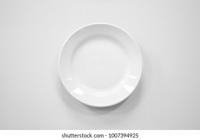 Photo of white empty plate on white background. Template isolated on white background. For graphic designers presentations and portfolios white mock-up with new plate.