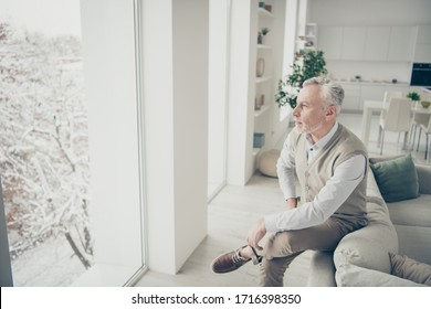 Photo of white haired aged man looking window deep thinking leaning sofa indoors