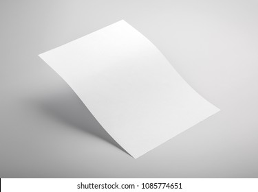 Photo of white letterhead isolated on gray background. Template for branding identity. For graphic designers presentations and portfolios. Letterhead isolated on gray. White letterhead mock-up.