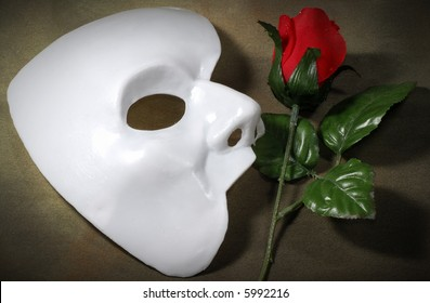 Photo of White Mask and a Fabric Rose - Opera Concept