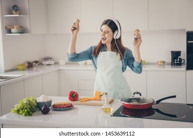 Photo of wife prepare family dinner overjoyed earflaps playlist hold hands spices containers playing coda best sound