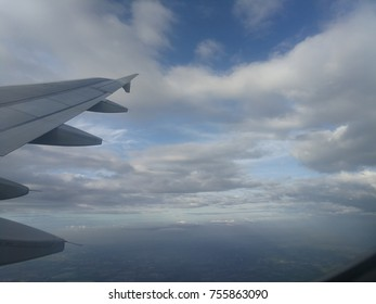 The photo from window of airplane. Skyscape with clearly blue skyand white beautiful cloudy