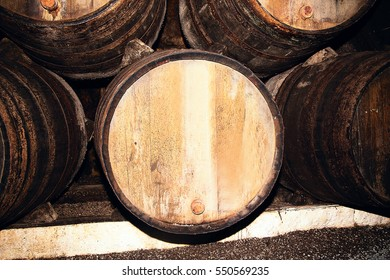 photo of Wine barrels in an underground cellar