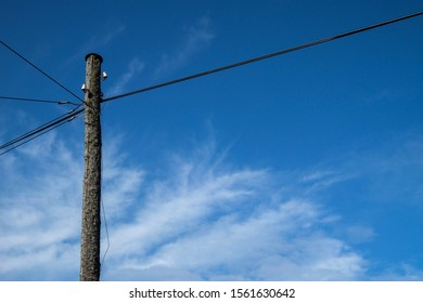 Photo of wired stake on blue sky background