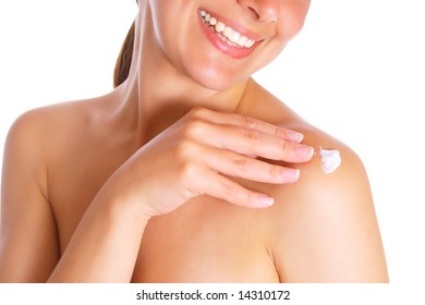 Photo of the woman with cream of shoulder