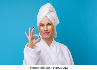 Photo of woman with gel pads under eyes and towel on her head