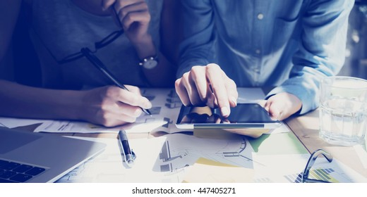 Photo Woman Hand Touching Digital Tablet Screen.Analyst Department Researching Process.Young Business Crew Working New Startup modern Studio.Analyze markets stocks.Blurred,film effect.Wide