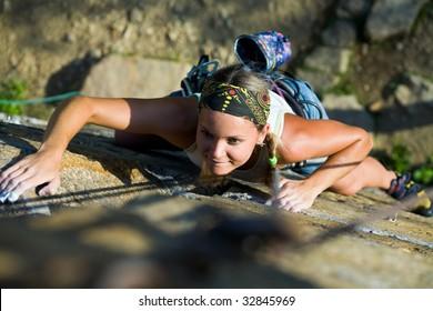 Photo of woman heartily climbing on mountain