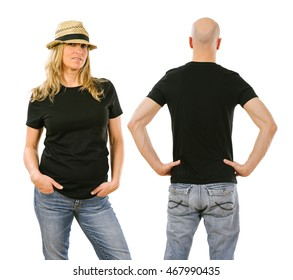 Photo of a woman and a man posing with a blank black t-shirt, ready for your artwork or design.