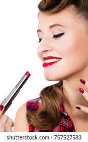 photo of Woman with pin-up hairstyle applying red lipstic