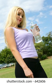 Photo of a woman with a water bottle.