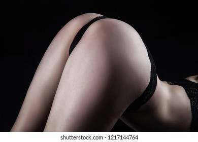 Photo of woman's buttocks in black panties