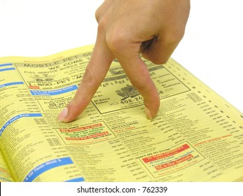A photo of a woman's fingers walking through the yellow pages