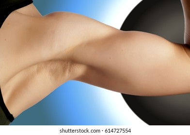Photo of a woman's hand. Young athlete shows Biceps. Close up of girl's hands with bicep,
