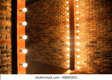 photo of Woman's makeup place with mirror and bulbs