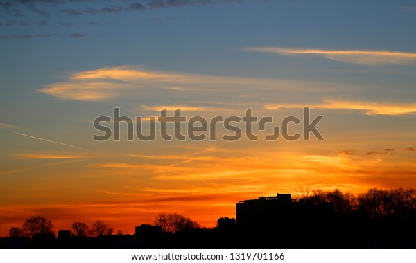 Photo of a wonderful sunset with houses and temples of Vladimir in winter