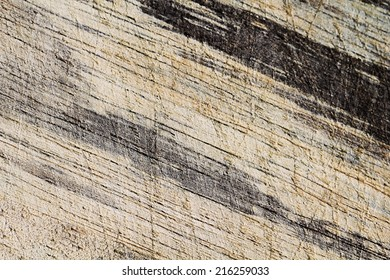 a photo of wood board scratched ,texture background