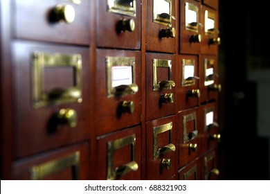 Photo of a wooden card catalog in a library