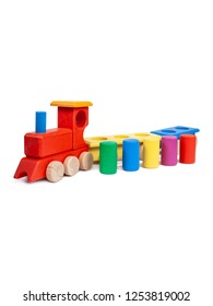 Photo of a wooden multi-colored train with cars on a white isolated background for the baby.