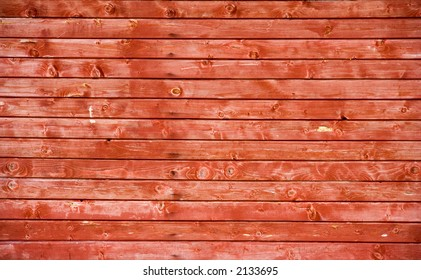 a photo of a wooden red fence