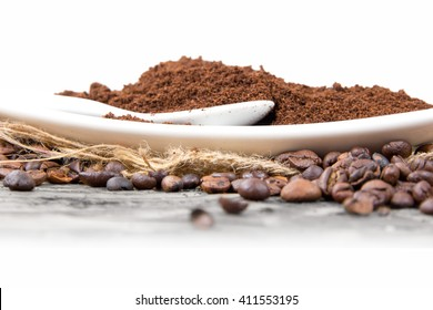 Photo of wooden spoon and bowl full of coffee beans on jute with white space