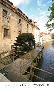 Photo of wooden watermill in certovka with wheel from wood