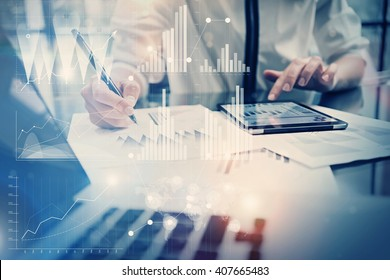 Photo working process. Account manager work new global project in office. Using tablet. Graphics icons, worldwide stock exchanges interface. Horizontal