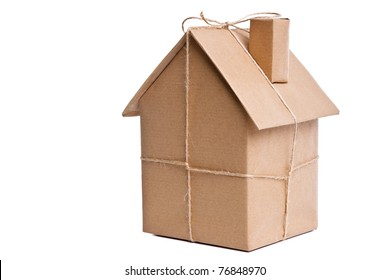 Photo of a wrapped house in brown recycled paper, cut out on a white background.