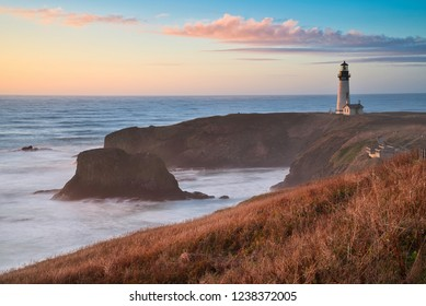 Photo of the Yaquina Head Lighthouse in Oregon at the sunset time
