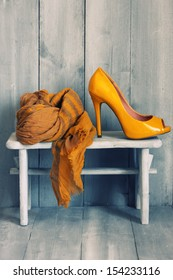 Photo of yellow shoes and scarf