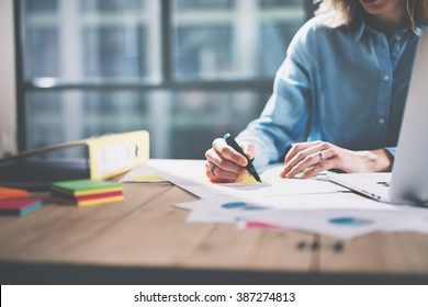 Photo young architect work concept. Woman working with new startup project in modern loft. Generic design notebook on wood table. Horizontal, film effect