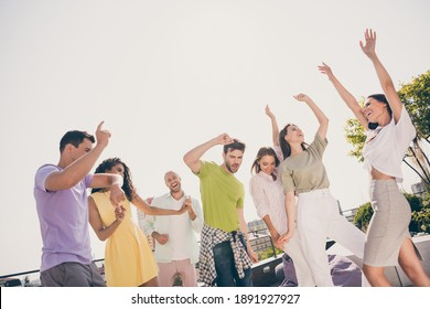 Photo of young attractive friends enjoy music have fun chill dance move hands up summer rooftop party