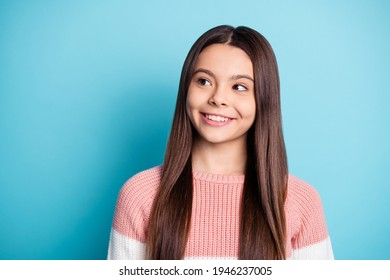 Photo of young attractive girl happy positive smile dream dreamy look empty space isolated over blue color background