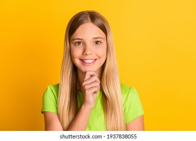 Photo of young attractive school girl happy positive smile think hand touch chin isolated over yellow color background