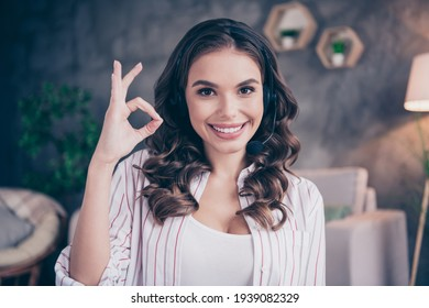 Photo of young attractive woman happy positive smile distance work headphones microphone call center support show okey sign indoors