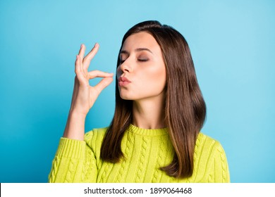 Photo of young attractive woman show gesture perfect tasty sign enjoy meal isolated over blue color background
