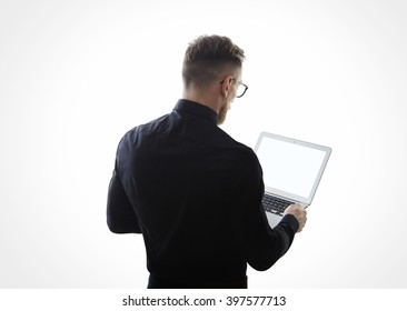 Photo of young bearded businessman wearing black shirt and holding contemporary notebook hands. White empty screen ready for you message. Isolated white background. Horizontal mockup