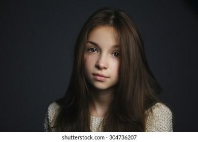 photo of young beautiful girl studio sensual