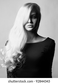 Photo of young beautiful lady with magnificent blond hair