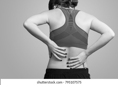 Photo of young beautiful woman on a theme pain in a back