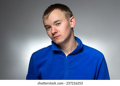 Photo of the young blond man on light background