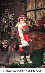 Photo of young boy playing in a Christmas garden